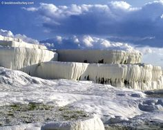 Pamukkale is a natural site in Denizli Province in southwestern Turkey. Pamukkale means Cotton Castle in Turkish, the name comes from its hot springs and travertines, terraces of carbonate minerals left by the flowing water.   http://www.booktravelturkey.com/turkey_tours/details/destinations/8/pamukkale