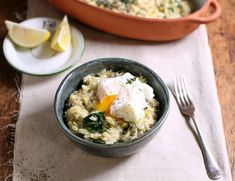 Baked Leek & Cheddar Risotto with Poached Eggs Recipe Abel And Cole, Vegetable Stock Cubes, Risotto Rice, Spinach Leaves, Poached Eggs, Mondays, Cheddar Cheese, Vegetarian, Stuffed Peppers