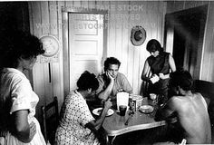 0993504 eating together. exhausted. hot. Freedom Summer marked the first time many black families in Mississippi had ever sat at the same table as whites for a meal.