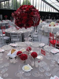 A pretty Liberty Island wedding tablescape -- love the look of mixing in a few different colored chairs! Brilliant!