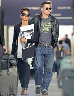 Halle Berry in oversized sunglasses and fiancé Olivier Martinez in aviators