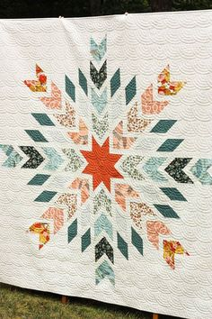Snowflake quilt made by Cotton Berry Quilts.  Quilt designed by Cristina Tepsick.