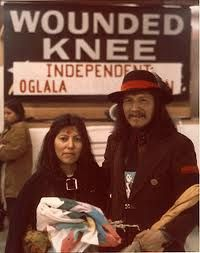 "In October 1971 AIM gathered members from across the country to a protest in Washington, D.C. known as the ""Trail of Broken Treaties."" AIM gained national attention when it seized the Bureau of Indian Affairs national headquarters and presented a 20-point list of demands of the federal government. In 1973 it led a 71-day armed standoff with federal forces at Wounded Knee, South Dakota, on the Pine Ridge Indian Reservation."