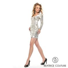 BB8876  Gorgeous sleek short dress with all over hand embelished pallates, mirrors and rectangular sequins. Long sheer hi-fashion sleeves.