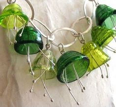 Glass bell flower necklace by Diana Ferreira (Art of Hand). Sterling chain, fine silver wire stamens, glass.