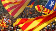 """People hold """"estelada"""" flags, Catalan separatist flags, during a gathering to mark the Calatalonia day """"Diada"""" in central Barcelona September 11, 2014. (Reuters / Albert Gea)"""