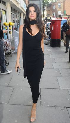 Selena Gomez wears a custom Atea Oceanie dress, a black scarf, and silver strappy Stuart Weitzman sandals