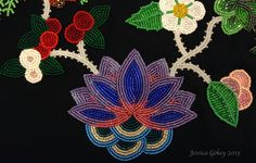 Close up on panel for MNHS Project: Designed and beaded by Jessica Gokey. Water flower and cranberries.