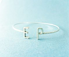Initial Cuff Bracelet Found! The Best Personalized Jewelry on Etsy via @WhoWhatWear