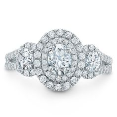 This vintage-inspired ring features three oval-cut diamonds, the largest an impressive 1/2 ct., arranged across the center.