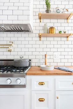 Favorite Kitchens of 2015 - I love the butcher block countertop in this all white kitchen. It gives it an ultra cool feel.