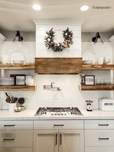 Haus Shiplap hood, whites and woods make for a beautiful farmhouse kitchen. For more farmhouse inspo White Farmhouse Kitchens, Farmhouse Kitchen Decor, Kitchen Redo, Home Kitchens, Kitchen Ideas, Wood Shelves In Kitchen, Industrial Shelving Kitchen, Ship Lap Kitchen, Kitchens With Open Shelving