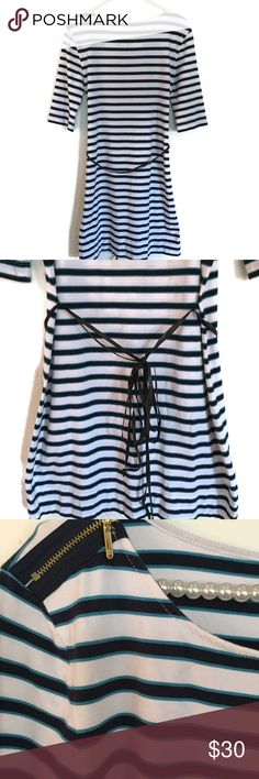 "Juicy Couture White Navy Striped Jersey Dress S Fashionable flattering slim fit striped dress in white and navy blue. Ballet neckline with gold zipper trim on shoulders and leather waist belt.  Material: 55% Cotton- 37% Modal- 8% Spandex  Length: 34""- Armpit to armpit: (Approx) 17""- 3/4 sleeve armpit to sleeve end: 9"" Smoke free/pet free home Juicy Couture Dresses Mini"