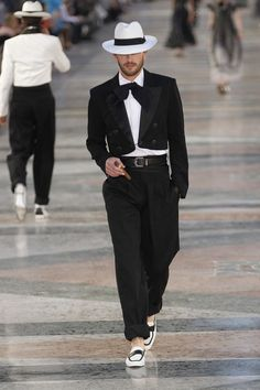 Chanel channels Cuba's golden age with a tailored look that features a cropped tuxedo jacket and panama hat.