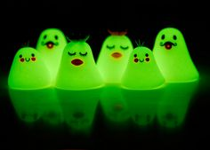 aren't these sweet? From Flickr- they're the Ghosts of Joojoo Land. Made of Glow-in-the-Dark polymer clay