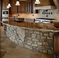 Beautiful rock island in the grand kitchen. Would want something simpler, but the idea is fabulous.