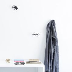 Check this out: Gancho: A Collection of Geometric Wall Hangers. https://re.dwnld.me/5jh9R-gancho-a-collection-of-geometric-wall-hangers