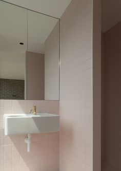 pink tiles - brass Vola tap - questionable basin trap - Duggan Morris - Peckham, London - 20xx