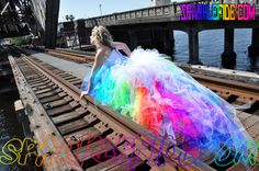 .:.Tutu dress fades throughout every color of the rainbow.:. White Corset top is supper adjustable and comes with both White and RaInBoW Lace<3 <3 Over 2000 yards of tulle. Glows In The Black Light. ((Ask About Adding LED LIGHTS)) This listing takes about 6 weeks to ship. Please send