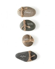 Knot some twine around flat stones for rustic wedding place cards. (Use a white paint pen or gel ink pen to write guests' names in script for an elegant contrast. Trendy Wedding, Rustic Wedding, Wedding Ideas, Party Wedding, Wedding Photos, Rustic Place Cards, Vintage Place Cards, Wedding Name Cards, Diy Wedding Place Cards