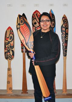 Front: Spawning Salmon by Roberta Quock. Left: Wolf Paddle by Stacy Calder. Right: Paddle by Lyle Quock Jr.