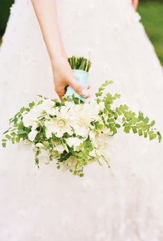 "Brides.com: All-White Wedding Bouquets. A Scabiosa Bouquet for an Informal Summer Wedding. Courtney Spencer, of Merriment Events in Richmond, Virginia, created this dainty posy for a classic wedding reception in a garden. ""We used scabiosas, sweet peas, and maidenhead ferns,"" she says. We love the robin's-egg-blue ribbon tied around the blunt stems as a very simple ""something blue."" See more summer wedding flower ideas."