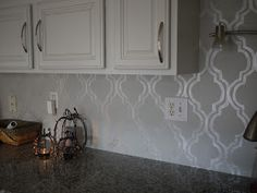 This is the beginning of the stenciled back splash we put into the kitchen. We cut out the cardboard piece and traced around each one. The...