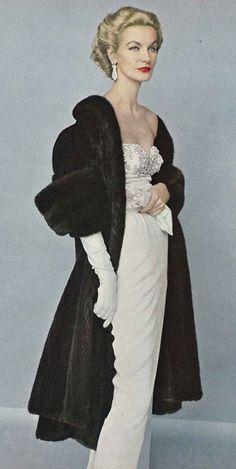 Sunny Harnet in a white dress and black fur coat, November Vogue 1952