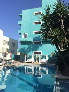 This boutique hotel is set in an iconic, turquoise colored building from It is located just a few steps from the beach in Ciutat Jardi, between the airport and Palma's old town. Outdoor Swimming Pool, Swimming Pools, Old Town, Spain, Turquoise, Boutique, Mansions, House Styles, Building