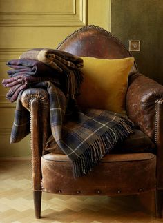 Classic leather chair and tartan throws perfect for reading a book and drinking hot chocolate #sainsburys #autumndreamhome