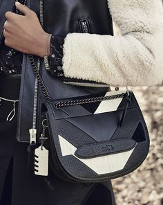 The Coach Shadow crossbody bag makes a statement in black-and-white patchwork leather.