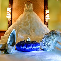 Beautiful wedding dress, sparkly heels, Cinderella's Coach locket and a brooch bouquet - the perfect accessories for a Disney bride