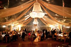 Gorgeous clear top tent with chandeliers.
