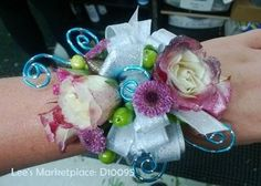 One of the beautiful custom wedding or dance corsages designed by Lee's Corner Floral. Learn more or order yours today at leesmarketplaceflorallogan.com