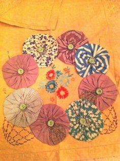 Nice embroidery with yo yo's.