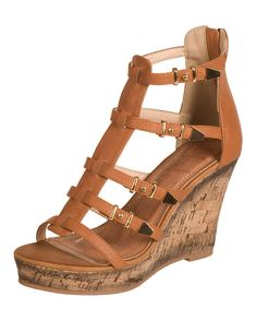Lending height and plenty of style, these strappy wedges boost for a look that suits many an occasion, from garden parties to dinner dates. Zipper closures ensure that steps don't falter.