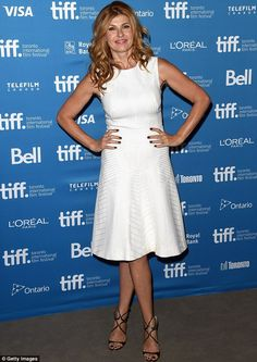 Wonder in white: Connie Britton, 47, donned a sleeveless, patterned midi-dress and strappy black leather heels