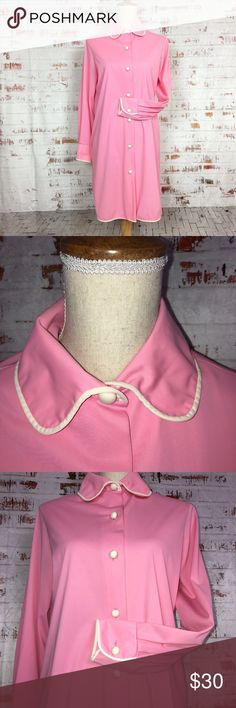 "Vintage Vanity Fair Pink & White Shirt Gown Vintage Vanity Fair Pink & White Button up Shirt Gown. 60/70's Vanity Fair Label. Round fabric covered buttons along the front of the gown as well as on the sleeve cuffs. As if this shirt gown couldn't get any sweeter, it also has a rounded collar, white piping along the hemline of the collar, cuff sleeves, also on the bottom hem line of the gown.1 pocket and 2 side slits.    Pit-pit: 20"" Shoulder-pit: 7"" Shoulder-Width: 16"" Sleeve Length: 22""…"