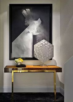Ultra modern foyer with large art and solid wood and gold console table