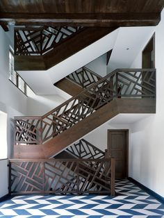 fretwork staircase, chevron floors