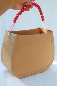 tutorial for cardboard handbags that kids can decorate.