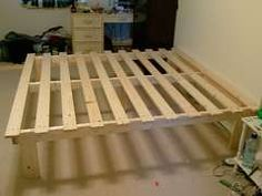 cheap bed frame build $30. Take this idea, remember my old A-frame futon, and come up with something more portable that will hold the futon and have storage space below.