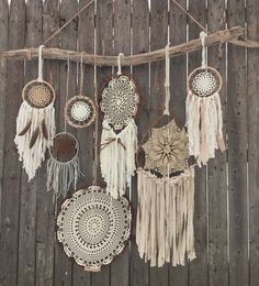 Driftwood + Doily Dreamcatchers Wall Hanging - The ultimate boho chic focal piece adding a simplistic earthy elegance to any room or wedding decor with its rustic driftwood and pheasant feathers and neutral-toned mixture of various crocheted doilies and fabrics, including leathers, lace, cotton and wool.