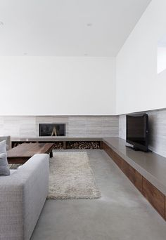 Storage cabinets and niches in the living room of the Carling residence in Muskoka, Canada designed by Tact Architecture