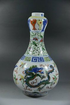 AN ANTIQUE CHINESE LONG TENG HU YUE PORCELAIN GOURD VAS Chinese Long Teng Hu Yue Porcelain Gourd Vase from circa 18th century 9''H X 4.5''D