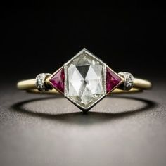 We've never seen one like this before! This rare,original early-Art Deco delight, dating from early 20th century, centers on a fabulous hexagonal-cut rose-cut diamond, weighing .74 carat. The unique stone flashes from within a foil-backed, finely milgrained, platinum bezel setting between a pair of  luscious red triangle Burma rubies set in contrasting 18K yellow gold, leading to a diamond-set banded ring shank. Singular and sensational. Not for everyday wear. Currently ring size 7 3/4