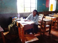 HopeCore's community health nurse, Winjoy, makes notes between patients at a school-based mobile clinic