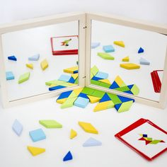 """Daily Mom's Toddler Air Travel Guide recommends our Magnetic Tangrams Travel Toy.  """"Ok, we know what you're thinking…small pieces! However, these magnetic pieces will stay right where they are placed on the magnetic white side of the Tangrams Travel Toy case. Let your child's imagination run wild creating designs with this amazing toy…"""""""