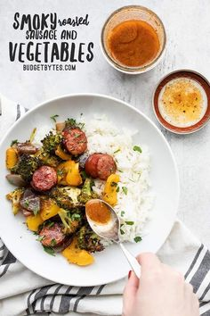 These Smoky Roasted Sausage and Vegetables are an easy sheet pan meal with a smoky homemade vinaigrette that gives an extra blast of flavor. BudgetBytes.com #sheetpanmeal #mealprep
