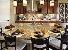 This kitchen provides room for seating while allowing the chef to cook and mingle. | Pulte Homes
